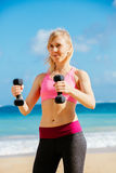 Fitness woman with barbells working out Stock Photos