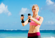Fitness woman with barbells working out Royalty Free Stock Images