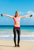 Fitness woman with barbells working out Stock Images