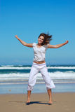 Fitness woman on beach. An active attractive caucasian white teenage fitness girl doing her excersises on the beach Stock Image