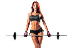 Fitness woman. Beautiful fitness female posing on studio background Royalty Free Stock Photo