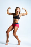 Fitness woman. Beautiful fitness female posing on studio background Royalty Free Stock Photos