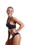 Fitness woman. Beautiful fitness female posing on studio background Stock Image