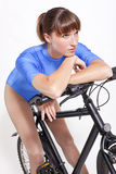 Fitness woman on bicycle Stock Photos