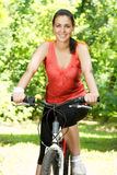 Fitness woman on bicycle Stock Photography