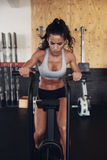 Fitness woman on bicycle doing cardio workout at gym Royalty Free Stock Images
