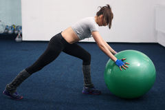 Fitness woman with big ball Royalty Free Stock Photography