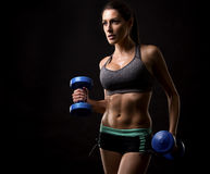 Fitness woman on black background Royalty Free Stock Photography