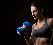 Fitness woman on black background Royalty Free Stock Photos