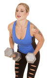 Fitness woman blue tank big weights lean Royalty Free Stock Photo