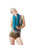 Fitness woman with blue towel. Isolated on white Royalty Free Stock Images