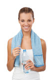 Fitness woman with bottle and towel Royalty Free Stock Photography