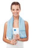 Fitness woman with bottle and towel Royalty Free Stock Photos