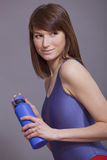 Fitness woman with bottle of water Royalty Free Stock Images