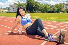 Fitness woman with bottle of water. Stock Image