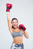 Fitness woman with boxing gloves celebrating her victory Stock Photos