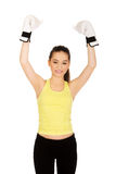 Fitness woman in boxing gloves with hands up. Royalty Free Stock Photography