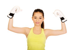 Fitness woman in boxing gloves with hands up. Royalty Free Stock Photo