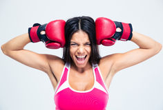 Fitness woman with boxing gloves screaming Royalty Free Stock Photography
