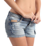 Fitness woman buttoning her shorts diet concept Stock Photos