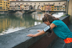 Fitness woman catching breathe in front of ponte vecchio in flor Stock Image