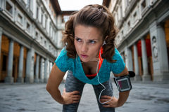 Fitness woman catching breathe near uffizi gallery in florence,. Italy Stock Photography