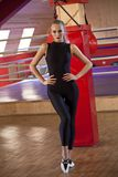 Fitness woman in catsuit. Posing in studio gym stock images