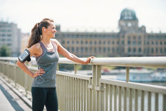 Fitness woman in the city looking into distance. Portrait of fitness young woman in the city looking into distance Royalty Free Stock Photos