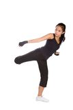 Fitness woman in combat stance. Young fitness female in combat stance as part of healthy lifestyle concept royalty free stock photos