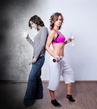 Fitness woman contrast. Unhappy tired negative woman and fresh positive fitness woman - contrast Royalty Free Stock Photo