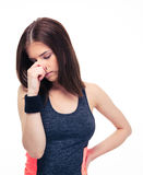 Fitness woman covering her nose with hand. Isolated on a white background Stock Images