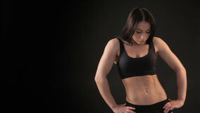 Fitness woman demonstrates her trained belly stock footage