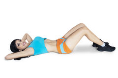 Fitness woman doing abdominal exercises Stock Photography
