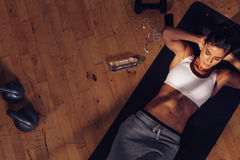 Fitness woman doing abs workout at the gym Stock Photo