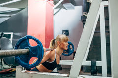 Fitness woman doing barbell squats in a gym Royalty Free Stock Image