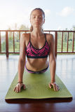 Fitness woman doing cobra pose yoga Royalty Free Stock Photo