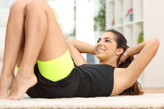 Fitness woman doing crunches on the floor Royalty Free Stock Photo