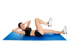 Fitness woman doing crunches on gym mat Stock Photography