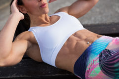 Fitness woman doing crunches outside Royalty Free Stock Photography
