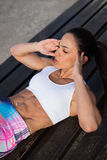 Fitness woman doing crunches outside Stock Photo