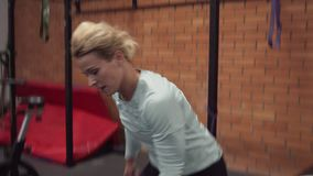 Fitness woman doing dumbbell snatch exercise at gym stock video