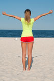 Fitness woman doing exercise on the beach. Stock Photos
