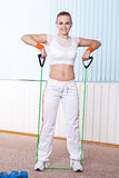 Fitness woman doing exercise with expander Stock Photography