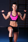 Fitness woman. Doing exercise in gym Royalty Free Stock Image