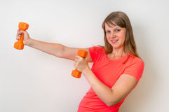 Fitness woman doing exercises with dumbbells Royalty Free Stock Photo