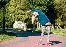 Fitness woman doing exercises during outdoor cross training workout in sunny morning Royalty Free Stock Photography
