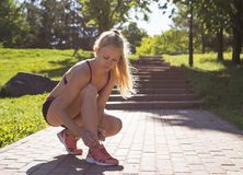 Fitness woman doing exercises during outdoor cross training workout in sunny morning Stock Photo