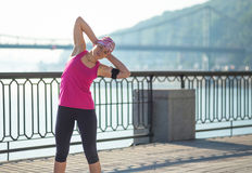 Fitness woman doing exercises during outdoor training workout Royalty Free Stock Photo