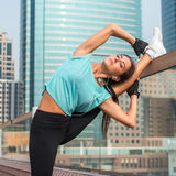Fitness woman doing feet elevated push-ups on a bench in the city. Sporty girl exercising outdoors Stock Photo
