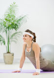 Fitness woman doing gymnastics exercises on floor Stock Images